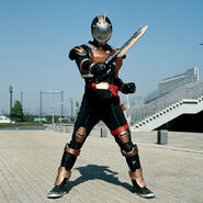 Riotrooper wielding Axelaygun Blade Mode
