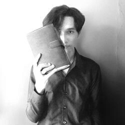 Akbar de Wighar with the book.jpg