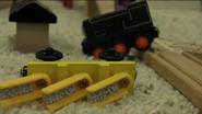 Sodor Railway Repair's ballast car beside a derailed Sidney