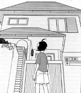 Futuki looking at his home