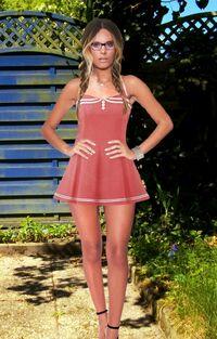 Sandra W (User Pain88) posing in a vintage dress.jpg