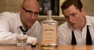 Kingsman2-whiskey-eggsy-merlin