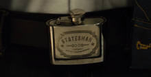 Statesman Flask belt buckle.png