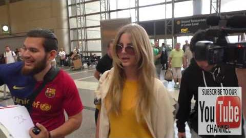 Lana Del Rey talks about her trip to Poland while departing at LAX Airport