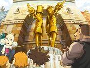 Layton und Phoenix Goldstatuen