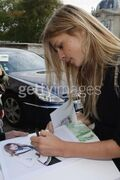 Clemence-poesy-signing autographs