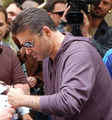 George Michael signing autographs