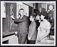 James D. Watson writing on blackboard