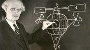 Auguste Piccard writing on blackboard