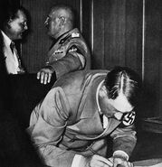 Hitler signing Munich Agreement (September 29, 1938)