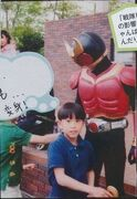 Young Gaku Sano with Kamen Rider Kuuga