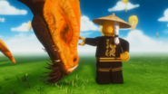 Der Erste Spinjitzu-Meister streichelt den goldenen Drachen