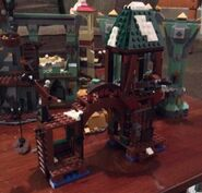79016-LEGO-Attack-on-Lake-Town-Building-e1410740503210-640x613