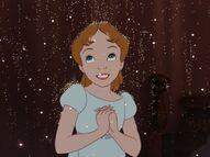 Wendy émerveillée par la poussière de fée