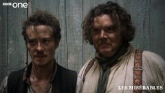 Enjolras and Grantaire facing firing squad.