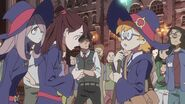 Akko about to apologize to Lotte for tearing her ancestral song sheet and other things