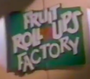 One 1995 logo for the fictitious Fruit Roll-Ups Factory. The word 'FACTORY' is slightly closer in style to the Fruit Roll-Ups logo.