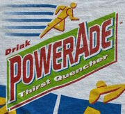 Red text in a tilted lime-green rectangle angled upwards spells out POWERADE in all capitals, with space for a subtitle underneath. The 'P' and the 'A' are taller than the rest, with the 'P' hanging farther down and the 'A' towering over the other letters. Differences from the previous version of the logo include rounder E's, shadows, and a redesigned runner at the top- now a yellow, gingerbread-cookie-resembling figure with five even speed lines that trail behind them.