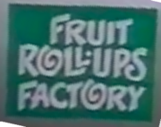 An updated logo for the fictitious Fruit Roll-Ups Factory- the 'O' in 'FACTORY' is also a swirl.
