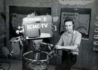 Arnold-morris-1958-running-camera-at-KCMC-TV-Texarkana-adjusted-400w