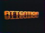 MV1 pre-promo ID - Attention - orange black - 2000
