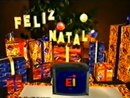 EI feliz natal red yellow logo presents tree ident