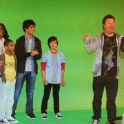 A Production still of the pilot showing some of the original actors standing in front of a green screen