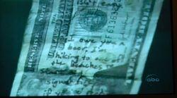 Mitad superior del billete de 20$ del Henry Gale original.