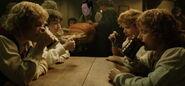 Фродо, Сэм, Мерри и Пиппен в Зелёном Драконе