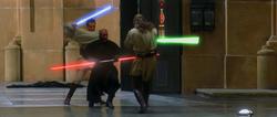 Three men fight with laser swords in a hangar.