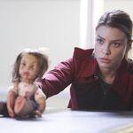 202 promo Chloe with doll.jpg