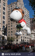 The-snoopy-the-flying-ace-helium-filled-balloon-floats-overhead-during-cbej28