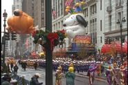 Snoopy-and-garfield-balloons-float-footage-000552219 prevstill.jpeg