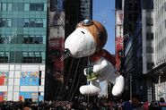 Snoopy-balloon-float-at-macys-85th-annual-thanksgiving-day-parade-DCWG2B