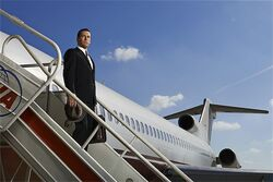 Mad Men S7 Don off plane.jpg