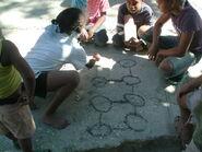 Children playin hoyito in Neiba