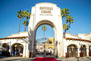 Stock-photo-park-entrance-gate-entertainment-los-angeles-blue-sky-palm-trees-hollywood-universal-studios-263dd0d5-61b7-4df3-b16c-6b7a94e6a2dd