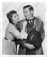 Patricia Barry and Errol Flynn