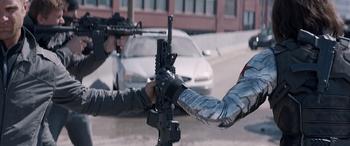 Bucky taking a gun.png