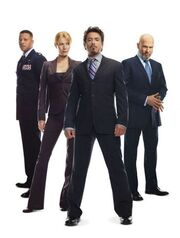 Anthony Stark (Earth-199999), Virginia Potts (Earth-199999), James Rhodes (Earth-199999) and Obadiah Stane (Earth-199999) from Iron Man (film) promo 001.jpg