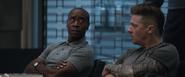 Rhodey and Barton listen to Thor