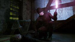 Murdock lits the flare to burn Ranskahov's open wound & sealing it.jpg