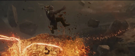 Thanos salta hacia Strange