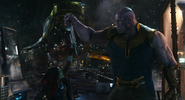 Thanos y Gamora luchando