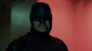 Daredevil pelea en el pasillo