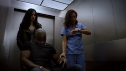 JJS01E13 Claire checks Luke pulse.png
