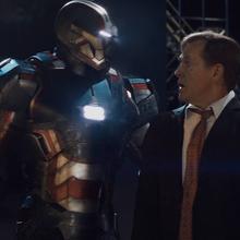 Iron Patriot y Ellis.png