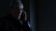 Malick habla por teléfono con Coulson
