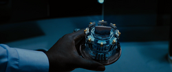 Rhodey holds Arc Reactor.png