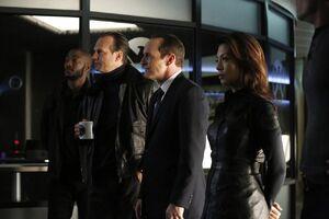 Antoine Triplett (Earth-199999), John Garrett (Earth-199999), Phillip Coulson (Earth-199999), and Melinda May (Earth-199999) from Marvel's Agents of S.H.I.E.L.D. Season 1 16 001.jpg